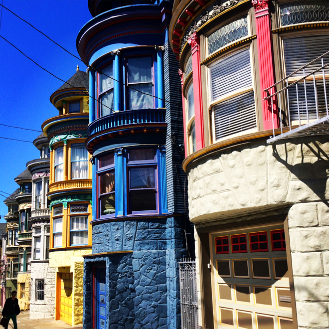 brightly painted houses on Central Avenue in the Haight-Ashbury district