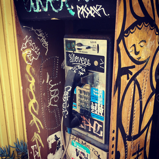graffitied phone booth in the Richmond