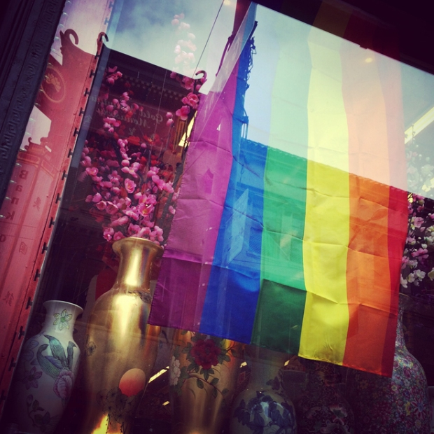 rainbow flag in window display in Chinatown