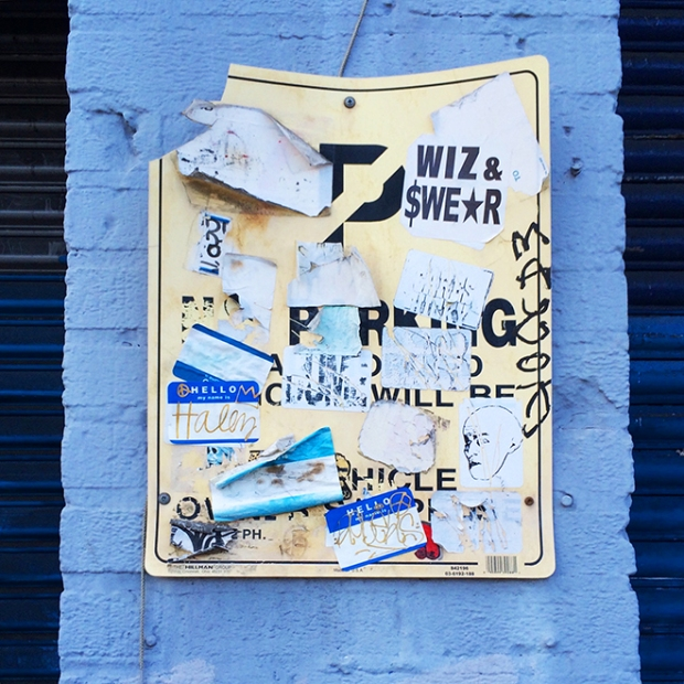 No Parking sign with tagger stickers, in blue