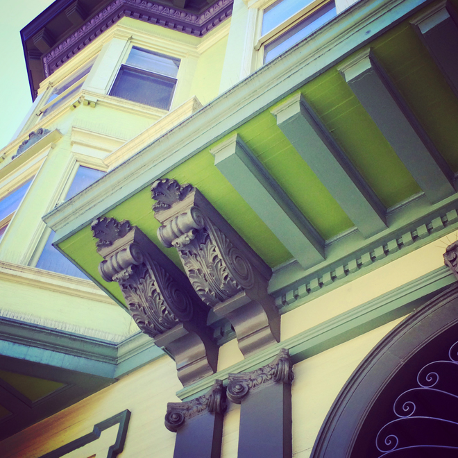 detail image of a victorian house painted many shades of green