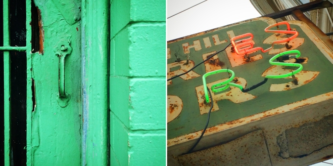 detail of green-painted wall and neon sign