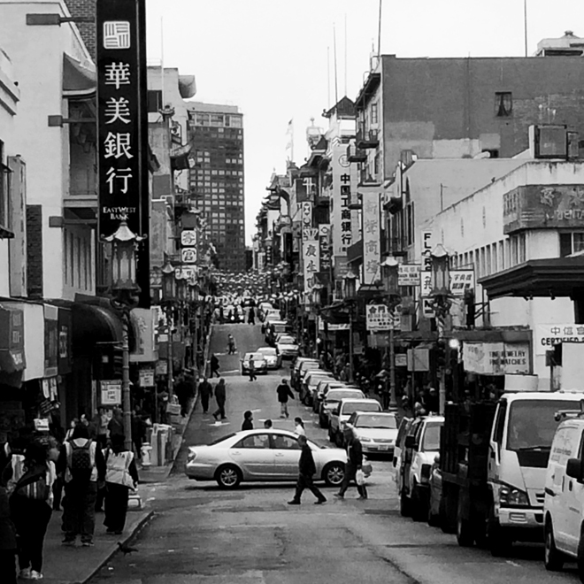 black and white street scene of a view of Chinatown in San Francisco