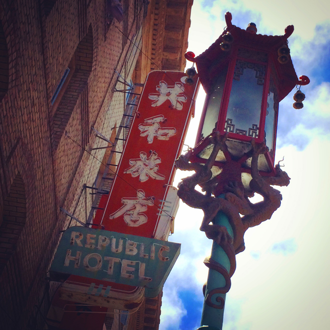 Old neon hotel sign and lamp post in Chinatown