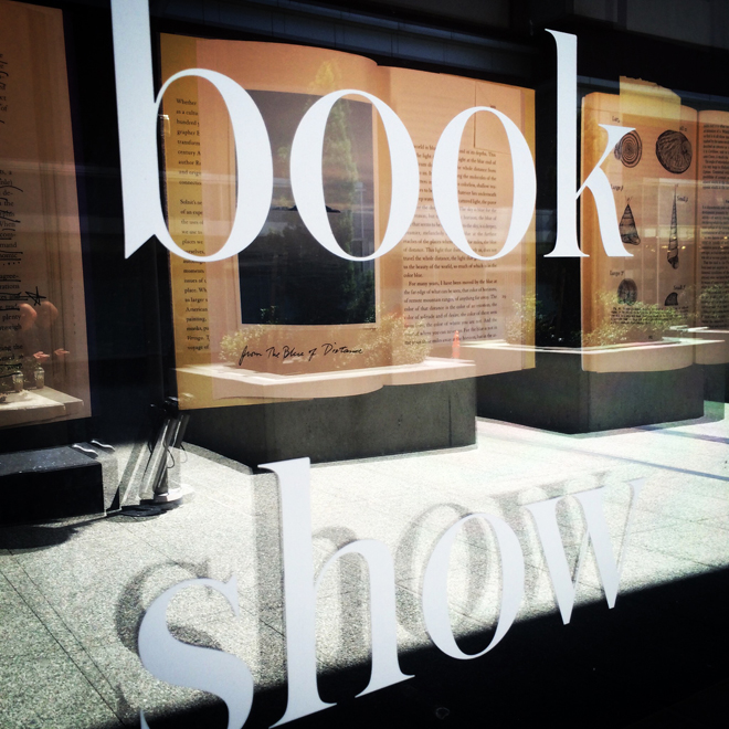 window sign reading: BOOK SHOW