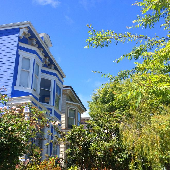sky blue house against bright blue sky