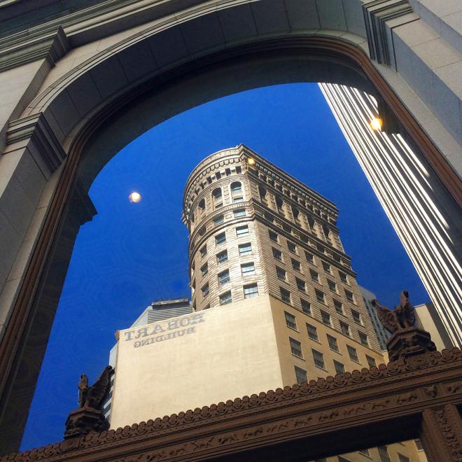 Hobart building reflected in the windows of Wells Fargo Bank