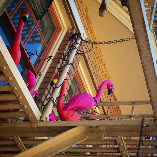 pink flamingos on a fire escape balcony on Haight Street