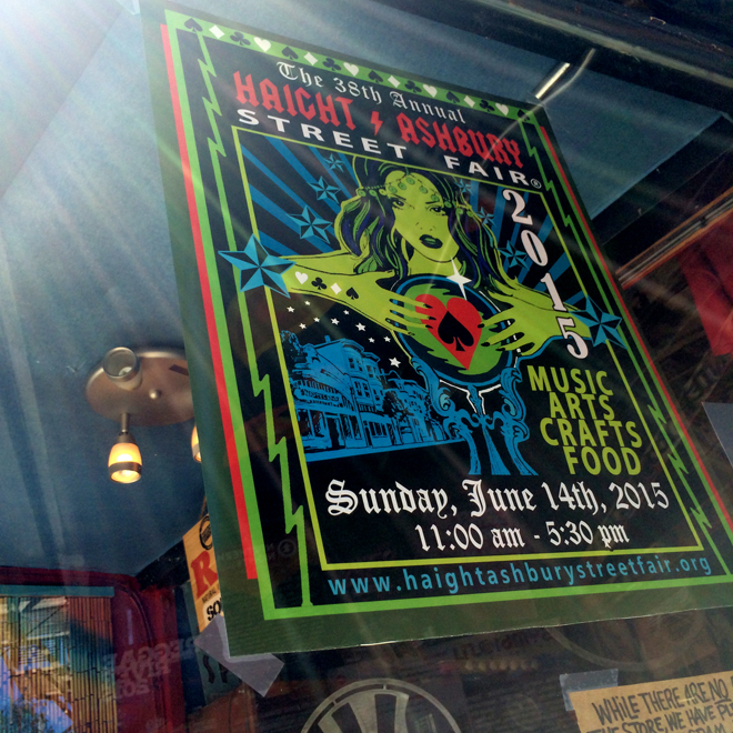 Haight Street Fair poster in shop window
