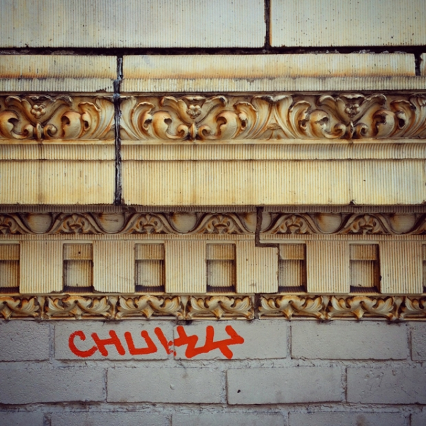graffiti tag on old building on Powell Street