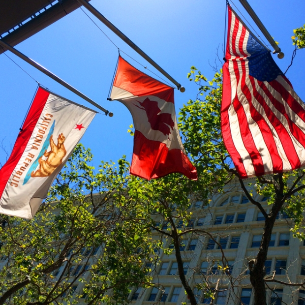 California, Canadian, and American flags on Market Street