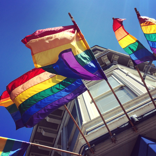rainbow flags outside of Moby Dick