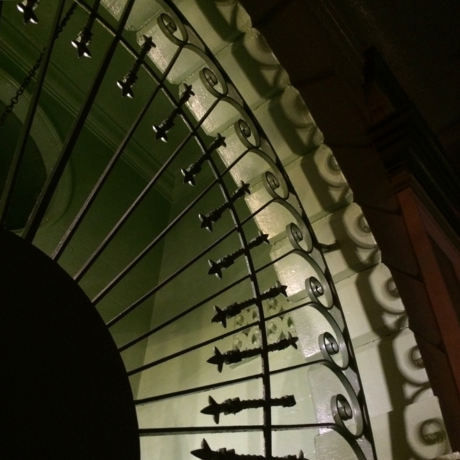 shadow and curly iron work, Mission District, San Francisco